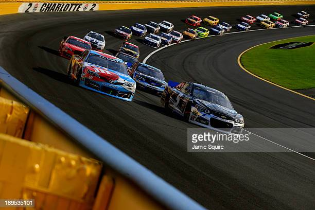 Kyle Busch driver of the MM's RedWhiteBlue MProve America Toyota and Kasey Kahne driver of the Time Warner Cable Chevrolet race during the NASCAR...