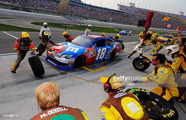 7db7d3070e9 Kyle Busch driver of the MMs RedWhiteBlue Toyota pits during the NASCAR  Sprint Cup Series Quaker