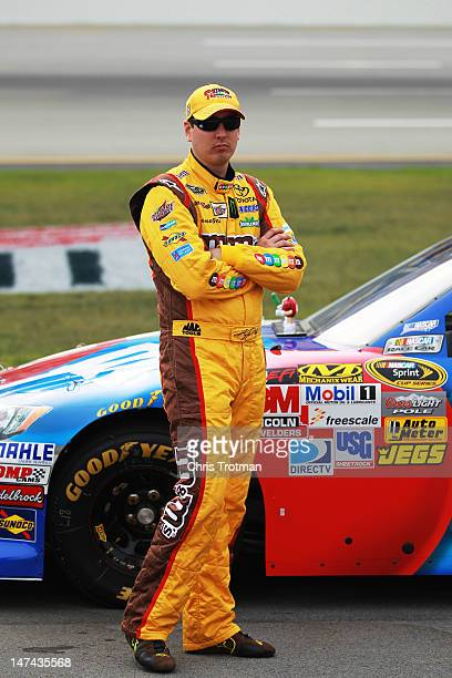 baea4ea13bf Kyle Busch driver of the MMs RedWhiteBlue Toyota stands on the grid during  qualifying for the
