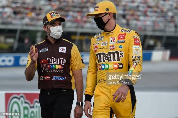 Kyle Busch driver of the MM's Toyota and crew chief Adam Stevens walk the grid prior to the NASCAR Cup Series AllStar Race at Bristol Motor Speedway...