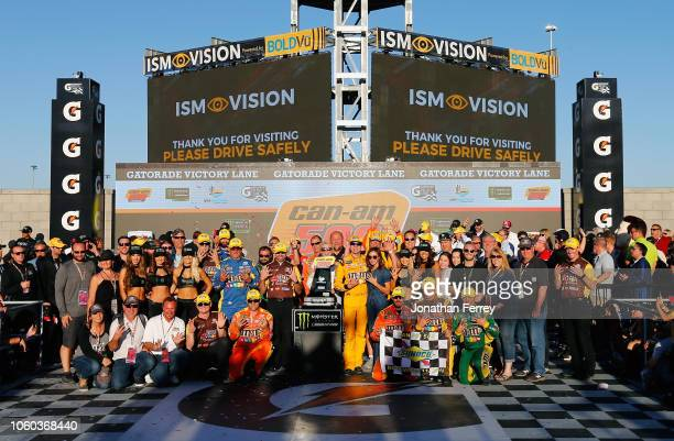 Kyle Busch driver of the MM's Toyota and his team celebrate in Victory Lane after winning the Monster Energy NASCAR Cup Series CanAm 500 at ISM...