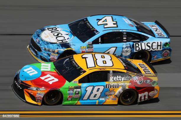 Kyle Busch driver of the MM's Toyota and Kevin Harvick driver of the Busch Beer Ford race during the weather delayed Monster Energy NASCAR Cup Series...