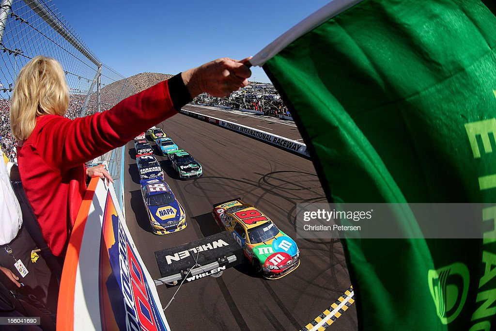 Kyle Busch, driver of the #18 M&M's Toyota, and Martin Truex Jr., driver of the #56 NAPA Auto Parts Toyota, lead the field to the green flag to start the NASCAR Sprint Cup Series AdvoCare 500 at Phoenix International Raceway on November 11, 2012 in Avondale, Arizona.