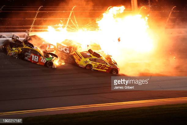 Kyle Busch, driver of the M&M's Toyota, Austin Cindric, driver of the Verizon 5G Ford, and Joey Logano, driver of the Shell Pennzoil Ford, are...