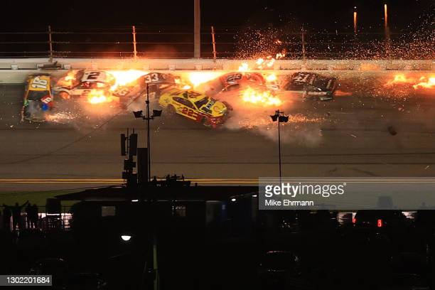 Kyle Busch, driver of the M&M's Toyota, Brad Keselowski, driver of the Discount Tire Ford, Austin Cindric, driver of the Verizon 5G Ford, Joey...