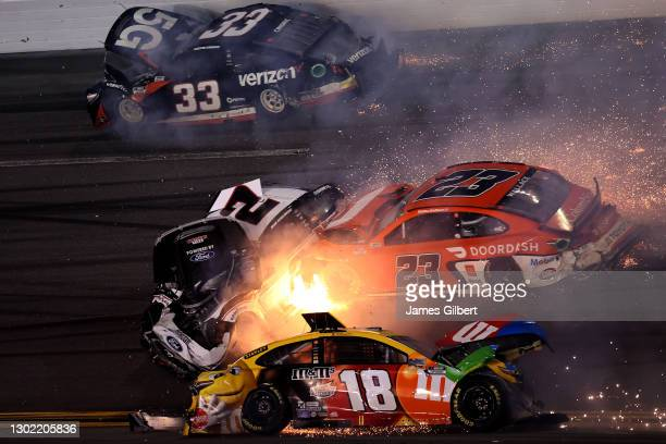 Kyle Busch, driver of the M&M's Toyota, Brad Keselowski, driver of the Discount Tire Ford, Bubba Wallace, driver of the DoorDash Toyota, and Austin...