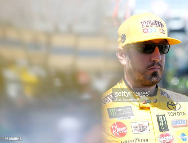 Kyle Busch, driver of the M&M's Toyota Camry Toyota, stands by his car during practice for the Monster Energy NASCAR Cup Series Quaker State 400...