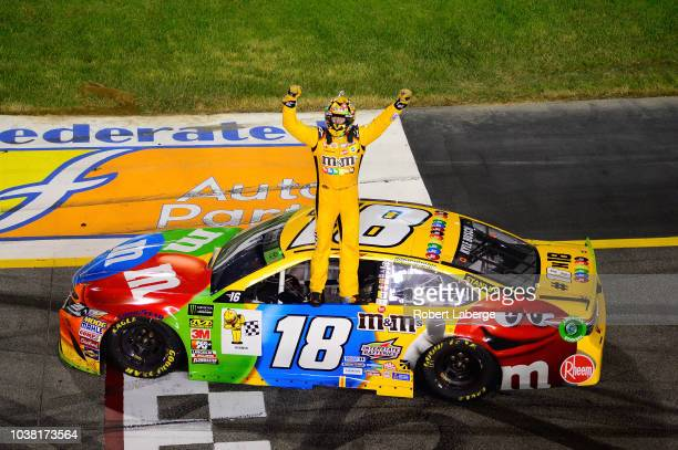 Kyle Busch driver of the MM's Toyota celebrates after winning the Monster Energy NASCAR Cup Series Federated Auto Parts 400 at Richmond Raceway on...