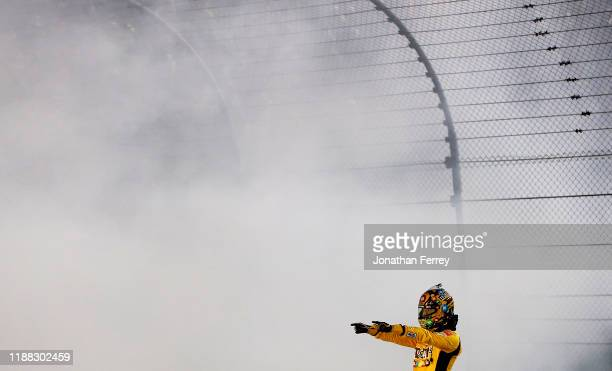 Kyle Busch driver of the MM's Toyota celebrates after winning the Monster Energy NASCAR Cup Series Ford EcoBoost 400 and the Monster Energy NASCAR...