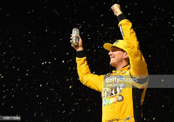 Kyle Busch driver of the MM's Toyota celebrates in Victory Lane after winning the Monster Energy NASCAR Cup Series Federated Auto Parts 400 at...