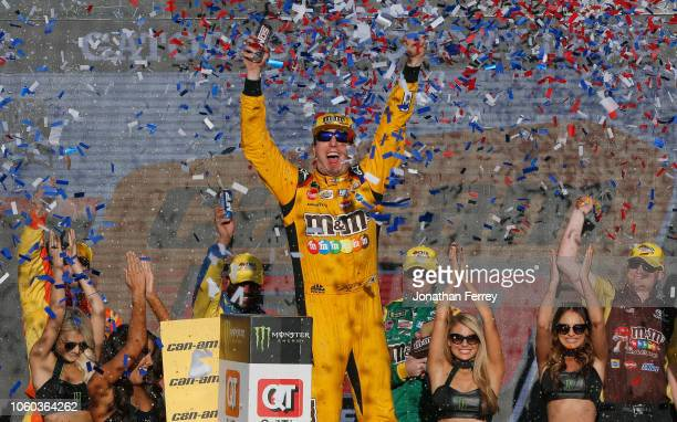 Kyle Busch, driver of the M&M's Toyota, celebrates in Victory Lane after winning the Monster Energy NASCAR Cup Series Can-Am 500 at ISM Raceway on...