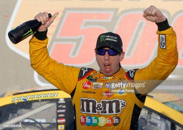 Kyle Busch driver of the MM's Toyota celebrates in Victory Lane after winning the Monster Energy NASCAR Cup Series CanAm 500 at ISM Raceway on...