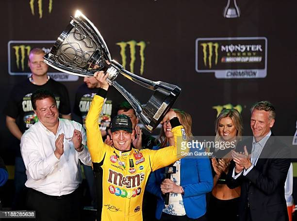 Kyle Busch driver of the MM's Toyota celebrates in victory lane after winning the Monster Energy NASCAR Cup Series Championship and the Monster...