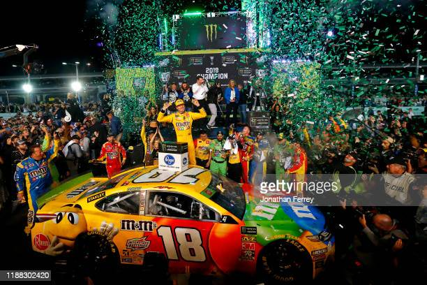 Kyle Busch driver of the MM's Toyota celebrates in Victory Lane after winning the Monster Energy NASCAR Cup Series Ford EcoBoost 400 and the Monster...