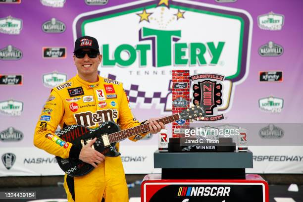 Kyle Busch, driver of the M&M's Toyota, celebrates in victory lane after winning the NASCAR Xfinity Series Tennessee Lottery 250 at Nashville...