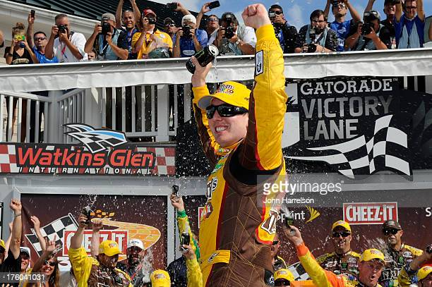 Kyle Busch, driver of the M&M's Toyota, celebrates in Victory Lane after winning the NASCAR Sprint Cup Series Cheez-It 355 at The Glen at Watkins...