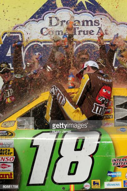 Kyle Busch driver of the MM's Toyota celebrates in victory lane after winning the NASCAR Sprint Cup Series Aaron's 499 at Talladega Superspeedway on...