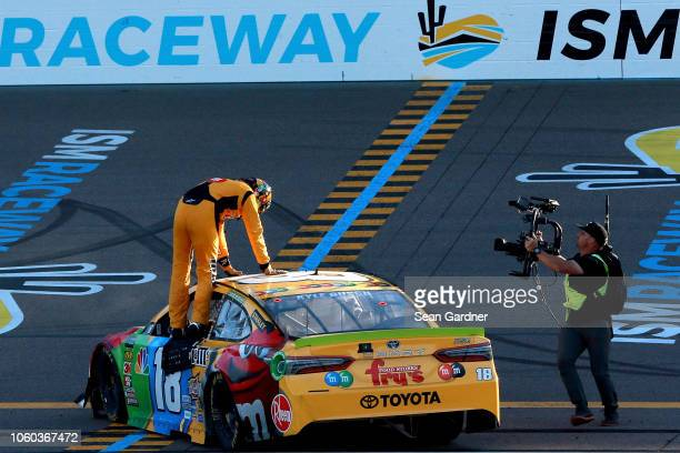 Kyle Busch driver of the MM's Toyota celebrates winning the Monster Energy NASCAR Cup Series CanAm 500 at ISM Raceway on November 11 2018 in Phoenix...