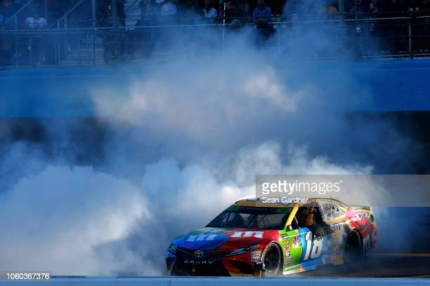 Kyle Busch driver of the MM's Toyota celebrates with a burnout after winning the Monster Energy NASCAR Cup Series CanAm 500 at ISM Raceway on...