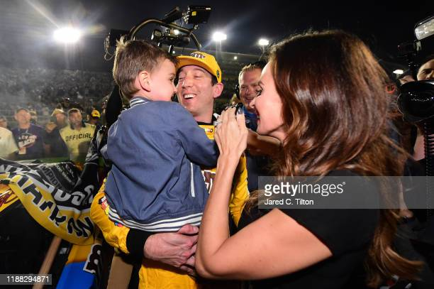 Kyle Busch driver of the MM's Toyota celebrates with his wife Samantha and their son Brexton after winning the Monster Energy NASCAR Cup Series Ford...
