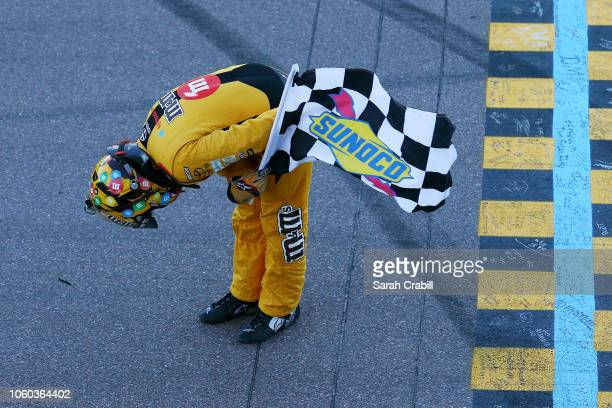 Kyle Busch driver of the MM's Toyota celebrates with the checkered flag after winning the Monster Energy NASCAR Cup Series CanAm 500 at ISM Raceway...