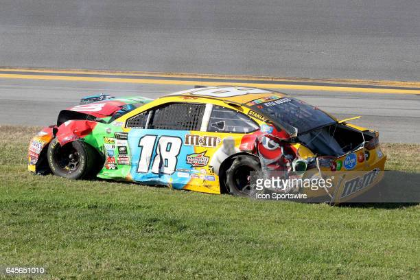 Kyle Busch driver of the MM's Toyota comes to a stop after a crash in turn 3 during the NASCAR Monster Energy Cup Series Daytona 500 on February 26...