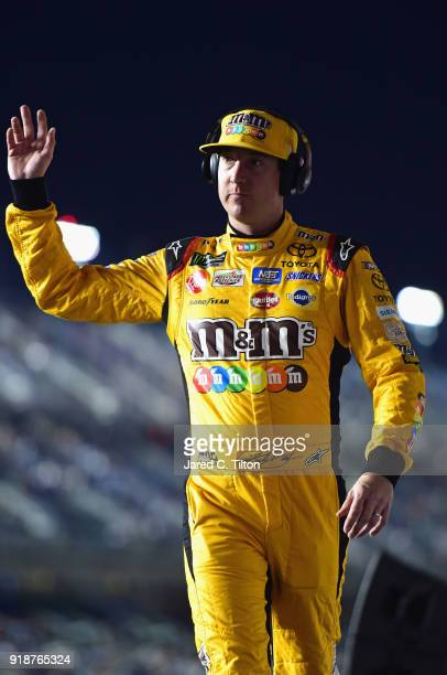 Kyle Busch driver of the MM's Toyota crosses the stage during driver introductions prior to the start of the Monster Energy NASCAR Cup Series CanAm...
