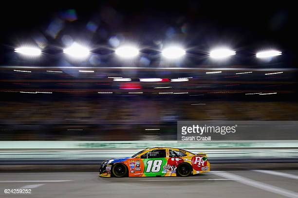 Kyle Busch driver of the MM's Toyota drives during qualifying for the NASCAR Sprint Cup Series Ford EcoBoost 400 at HomesteadMiami Speedway on...