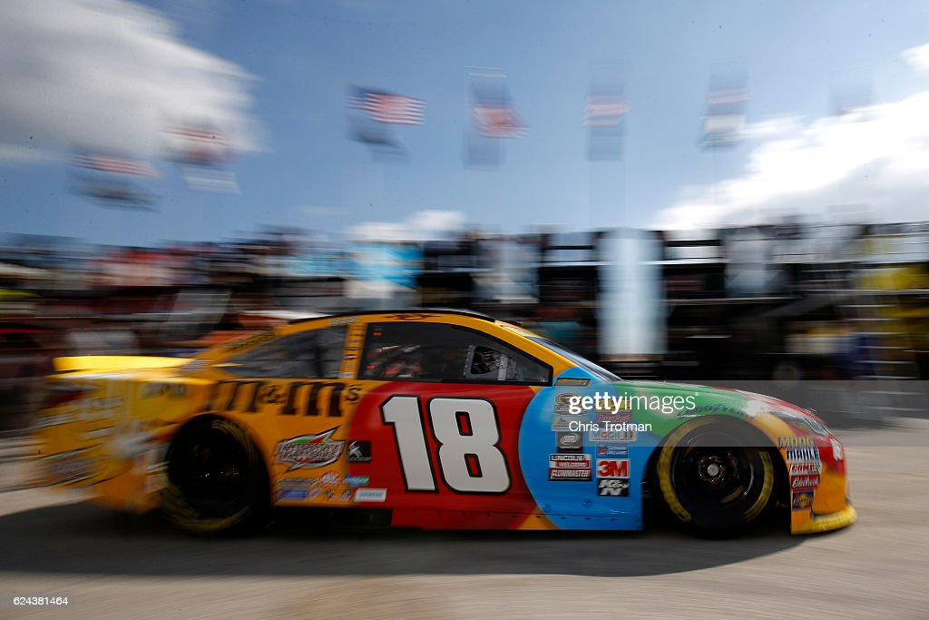 Kyle Busch, driver of the #18 M&M's Toyota, drives through the garage area during practice for the NASCAR Sprint Cup Series Ford EcoBoost 400 at Homestead-Miami Speedway on November 19, 2016 in Homestead, Florida.