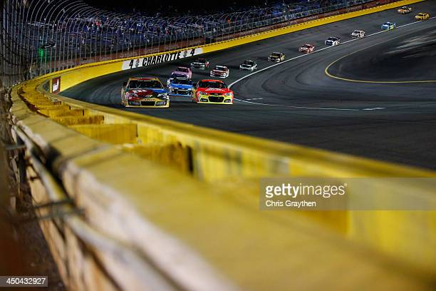Kyle Busch driver of the MM's Toyota during the NASCAR Sprint Cup Series Bank of America 500 at Charlotte Motor Speedway on October 12 2013 in...