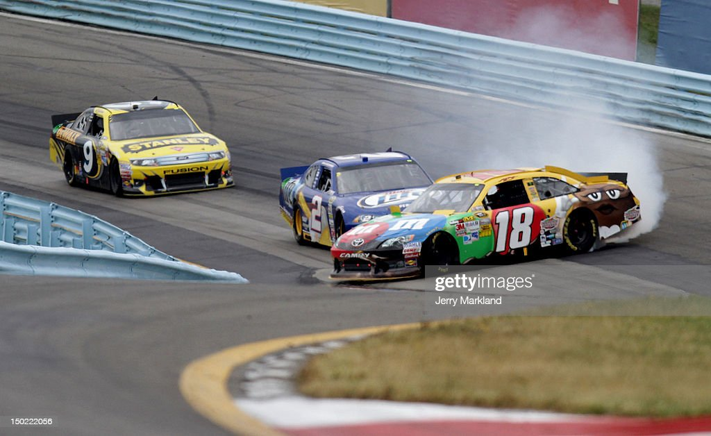 Kyle Busch, driver of the #18 M&M's Toyota, is involved in an incident ahead of Brad Keselowski, driver of the #2 Miller Lite Dodge, and Marcos Ambrose, driver of the #9 Stanley Ford, during the NASCAR Sprint Cup Series Finger Lakes 355 at the Glen at Watkins Glen International on August 12, 2012 in Watkins Glen, New York.