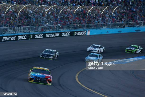 Kyle Busch driver of the MM's Toyota leads a group of cars during the Monster Energy NASCAR Cup Series CanAm 500 at ISM Raceway on November 11 2018...