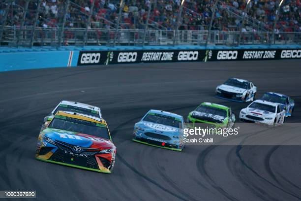 Kyle Busch driver of the MM's Toyota leads a pack of cars during the Monster Energy NASCAR Cup Series CanAm 500 at ISM Raceway on November 11 2018 in...