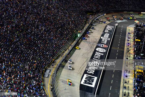 Kyle Busch, driver of the M&M's Toyota, leads a pack of cars during the Monster Energy NASCAR Cup Series Bass Pro Shops NRA Night Race at Bristol...