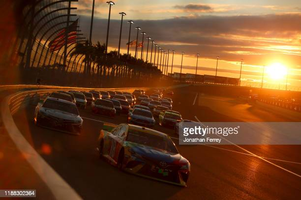 Kyle Busch driver of the MM's Toyota leads a pack of cars during the Monster Energy NASCAR Cup Series Ford EcoBoost 400 at Homestead Speedway on...