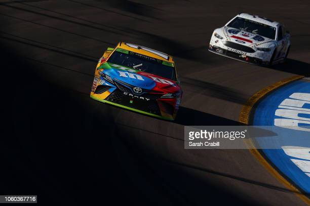 Kyle Busch driver of the MM's Toyota leads Brad Keselowski driver of the Miller Lite Ford during the Monster Energy NASCAR Cup Series CanAm 500 at...