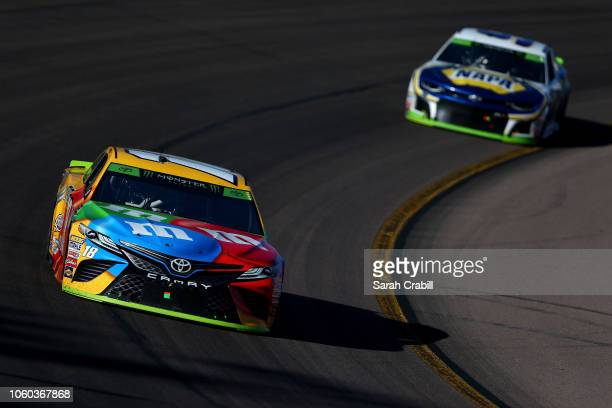 Kyle Busch driver of the MM's Toyota leads Chase Elliott driver of the NAPA Auto Parts Chevrolet during the Monster Energy NASCAR Cup Series CanAm...