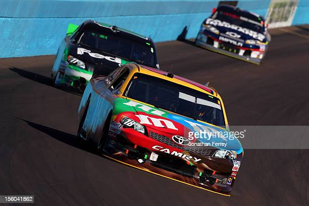 Kyle Busch driver of the MM's Toyota leads Denny Hamlin driver of the FedEx Ground Toyota and Kasey Kahne driver of the Farmers Insurance Chevrolet...