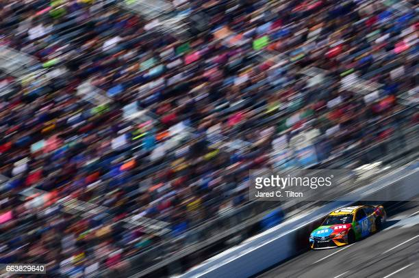 Kyle Busch driver of the MM's Toyota leads during the Monster Energy NASCAR Cup Series STP 500 at Martinsville Speedway on April 2 2017 in...