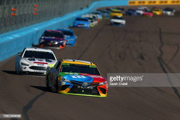 Kyle Busch driver of the MM's Toyota leads the field during the Monster Energy NASCAR Cup Series CanAm 500 at ISM Raceway on November 11 2018 in...