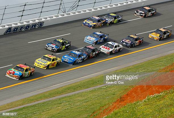 Kyle Busch driver of the MM's Toyota leads the field during the NASCAR Sprint Cup Series Aaron's 499 at Talladega Superspeedway on April 27 2008 in...
