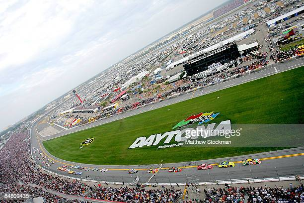 Kyle Busch driver of the MM's Toyota leads the field during the NASCAR Sprint Cup Series Daytona 500 at Daytona International Speedway on February 15...