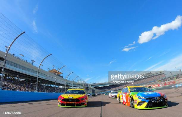 Kyle Busch, driver of the M&M's Toyota, leads the field to the green flag at the satrt of the Monster Energy NASCAR Cup Series Bluegreen Vacations...