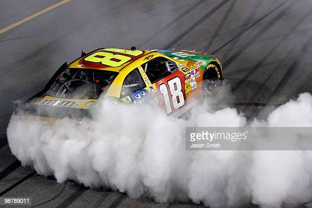 Kyle Busch, driver of the M&M's Toyota, performs a burnout in celebration of winning the NASCAR Sprint Cup Series Crown Royal Presents the Heath...