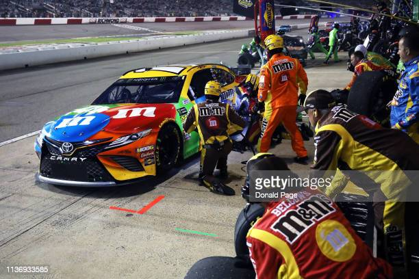 Kyle Busch driver of the MM's Toyota pits during the Monster Energy NASCAR Cup Series Toyota Owners 400 at Richmond Raceway on April 13 2019 in...