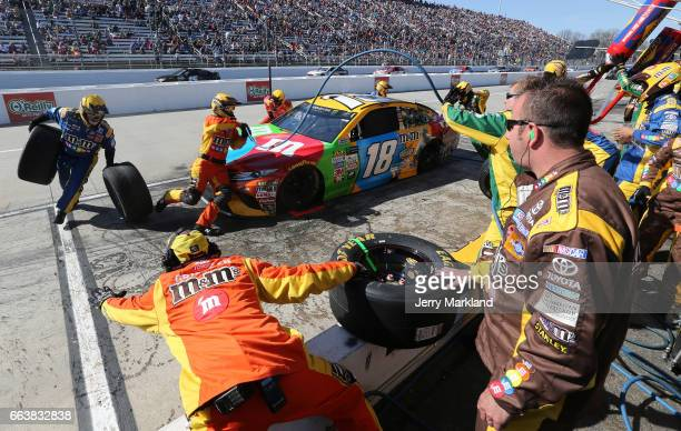 Kyle Busch driver of the MM's Toyota pits during the Monster Energy NASCAR Cup Series STP 500 at Martinsville Speedway on April 2 2017 in...