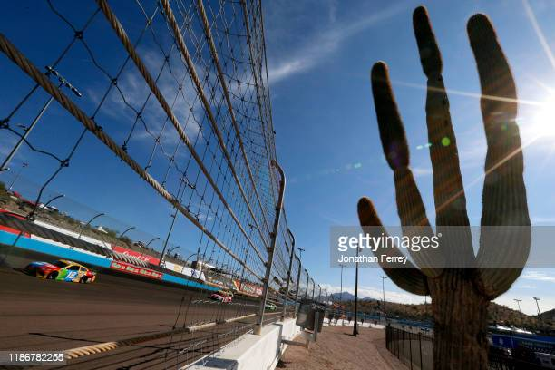 Kyle Busch, driver of the M&M's Toyota, races during the Monster Energy NASCAR Cup Series Bluegreen Vacations 500 at ISM Raceway on November 10, 2019...