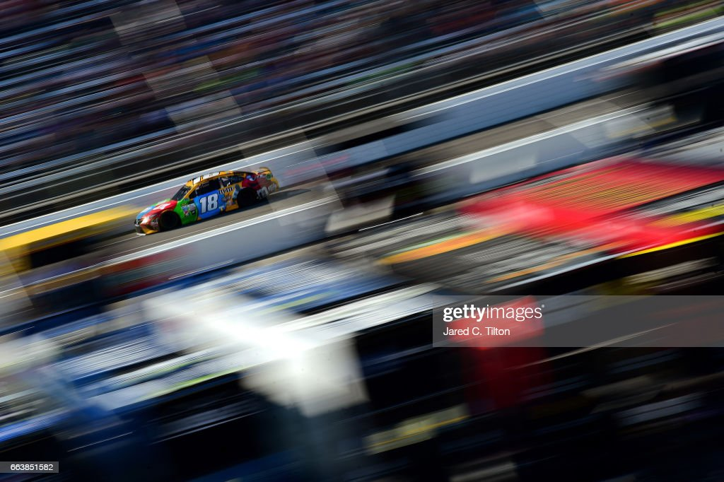 Kyle Busch, driver of the #18 M&M's Toyota, races during the Monster Energy NASCAR Cup Series STP 500 at Martinsville Speedway on April 2, 2017 in Martinsville, Virginia.