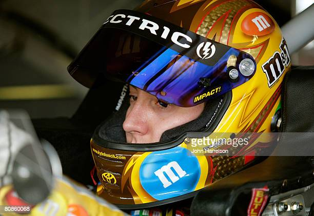 Kyle Busch driver of the MM's Toyota sits in car during practice for the NASCAR Sprint Cup Series Aaron's 499 at Talladega Superspeedway on April 25...