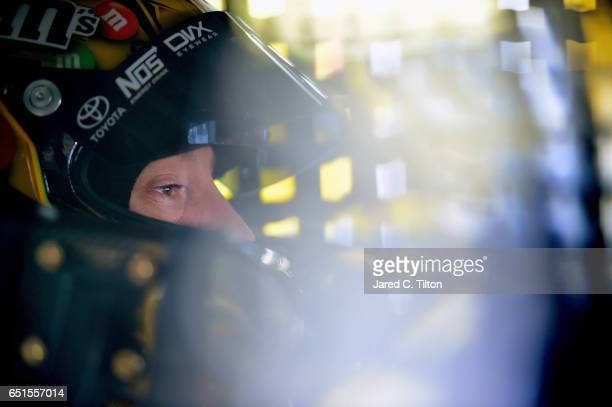 Kyle Busch driver of the MM's Toyota sits in his car during practice for the Monster Energy NASCAR Cup Series Kobalt 400 at Las Vegas Motor Speedway...